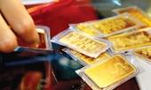 Vàng trong nước giảm theo vàng thế giới