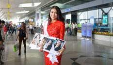 Lệ Hằng mặc váy ren đỏ rực ra sân bay đi thi Miss Universe