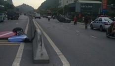 Xế hộp Mazda CX5 đâm phân cách rồi lật ngửa giữa quốc lộ