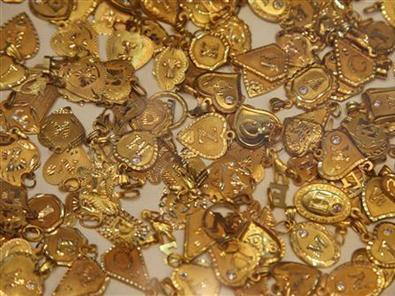 Vàng thế giới lại tăng lên mức cao nhất trong ba tuần