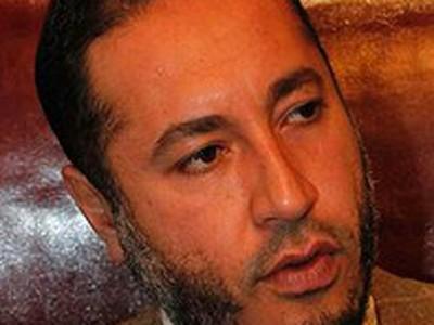 Hé lộ người giúp con trai Gaddafi tháo chạy