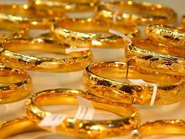 Giá vàng trong nước tăng, thế giới giảm