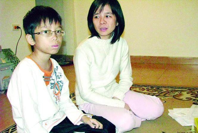 Mẹ và Tít Ảnh: Tr.T