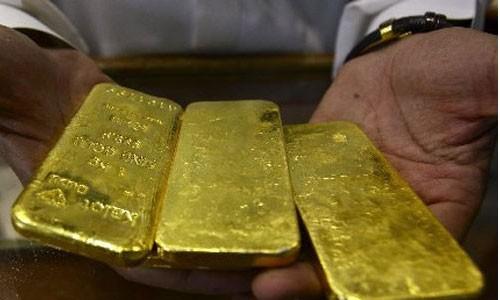 Vàng sẽ chịu áp lực nếu đôla Mỹ tiếp tục đắt lên và Cục Dự trữ liên bang điều chỉnh tăng lãi suất cơ bản.