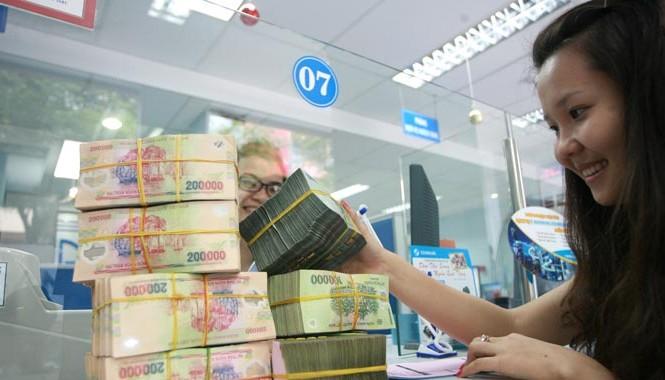 Theo ông Cao Sỹ Kiêm, nếu để nợ xấu trôi đi sẽ nguy hiểm cho ngân hàng. Ảnh: Như Ý.