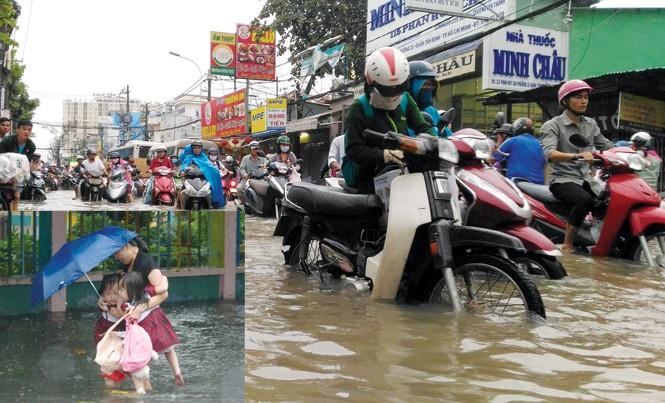 Trận mưa sáng ngày 3/10 TP HCM lại trong biển nước. Ảnh: PV.
