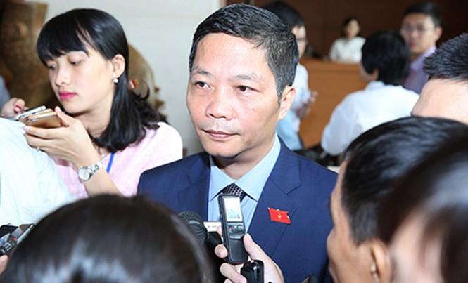 Bộ trưởng Trần Tuấn Anh trao đổi với báo chí ngày 6/1.