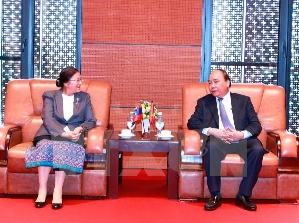 Thủ tướng Nguyễn Xuân Phúc tiếp Chủ tịch Quốc hội Lào Pany Yathotou. (Ảnh: Thống Nhất/TTXVN)