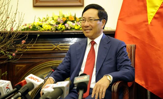 Phó Thủ tướng, Bộ trưởng Ngoại giao Phạm Bình Minh trả lời báo chí ngày 5/1 tại Hà Nội. Ảnh: Trúc Quỳnh