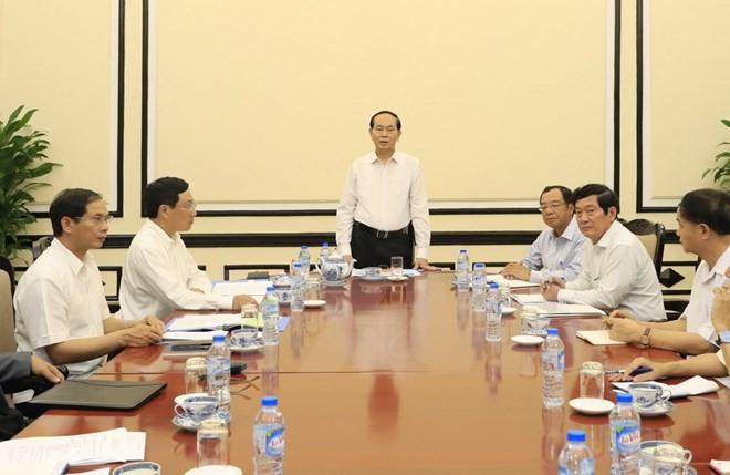 Chủ tịch nước Trần Đại Quang làm việc với lãnh đạo Ủy ban Quốc gia APEC 2017 về công tác chuẩn bị Tuần lễ Cấp cao APEC 2017. (Ảnh: Nhan Sáng/TTXVN)