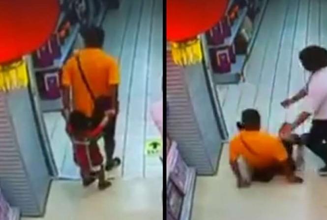 Khoảnh khắc người bố ngã đè lên con trai được ghi lại bởi camera giám sát.