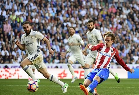 Griezmann giải cứu Atletico thoát thua Real