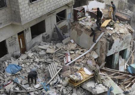 Một tòa nhà bị phá hủy trong xung đột Syria