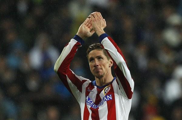 Torres hân hoan với cú đúp vào lưới Real Madrid.