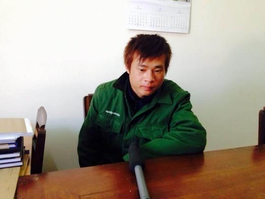 Đối tượng Nguyễn Văn Tiến tại cơ quan điều tra. Ảnh: Hữu Trường
