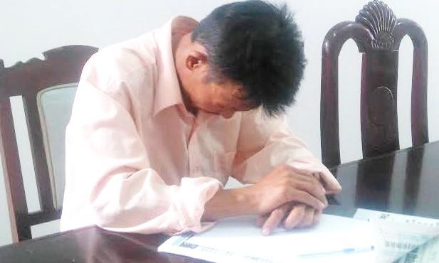 Anh Nguyễn Đình Quang tại cơ quan công an. Ảnh: Nguyên Vũ