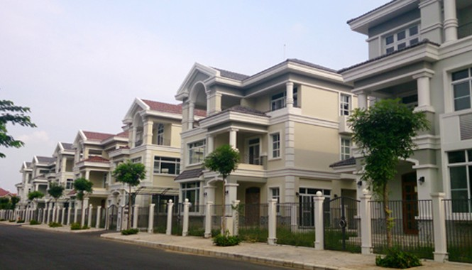 Các chuyên gia cho rằng bất động sản năm 2015 sẽ tươi sáng hơn năm 2014 và có thể kỳ vọng mức lợi nhuận 15-20% tùy phân khúc. Ảnh: Vũ Lê.