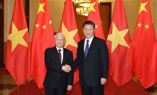 Tổng Bí thư Nguyễn Phú Trọng và Tổng Bí thư, Chủ tịch Trung Quốc Tập Cận Bình tại Đại lễ đường Nhân dân Trung Quốc. Ảnh: TTXVN.