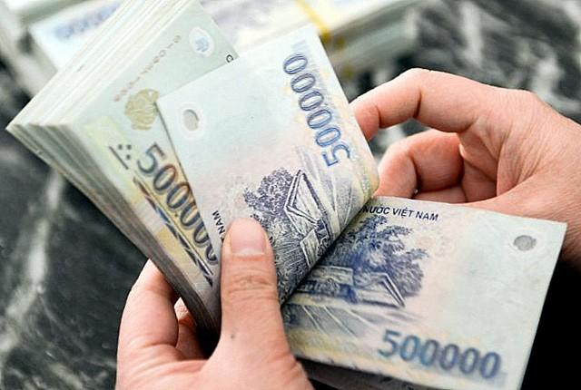 Thông tư 13 nêu rõ việc rút tiền mặt vượt quá định mức phải đăng ký trước.