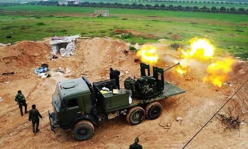 Pháo phòng không quân đội Syria khai hỏa. Ảnh: Al Masdar News.