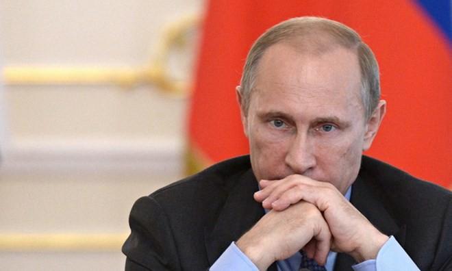 Thế giới đang dõi theo nước Nga và Tổng thống Putin trong cơn bão khó khăn hiện tại. (Nguồn: AFP)