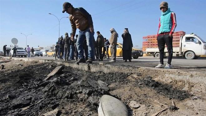 Hiện trường vụ đánh bom xe ở Iraq. (Nguồn: AP)