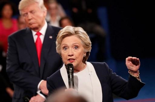 Ảnh ấn tượng trong cuộc tranh luận thứ 2 của Trump và Clinton - ảnh 8