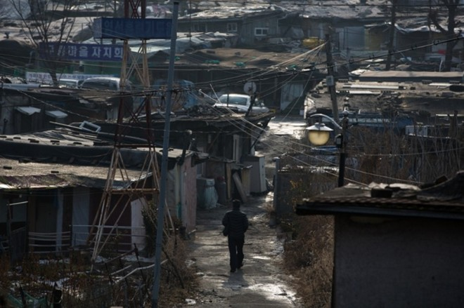 [ẢNH] Cuộc sống tạm bợ tại khu ổ chuột lớn nhất Seoul - ảnh 4