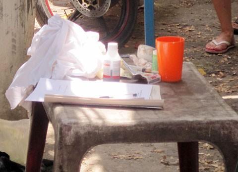Tang  vật là chai thuốc trừ sâu mà cơ quan điều tra tìm thấy tại nhà bà Liên