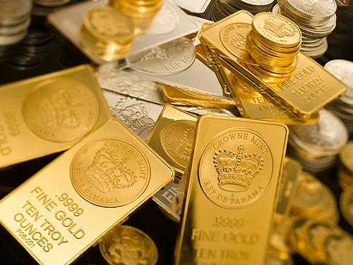 Giá vàng thế giới giảm sau khi Cộng Hòa Síp thông qua gói cứu trợ tài chính. Ảnh: Reuters