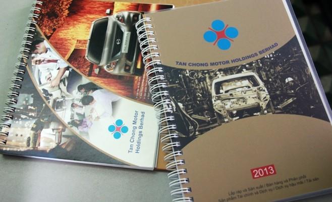 Bìa hai ấn phẩm in hình ảnh tập đoàn Tan Chong