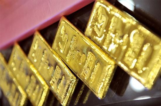 Vàng thế giới chưa thể phục hồi dù đồng USD giảm