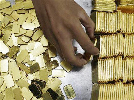 Giá vàng thế giới đã chạm mức cao nhất trong hai tuần. Ảnh: reuters