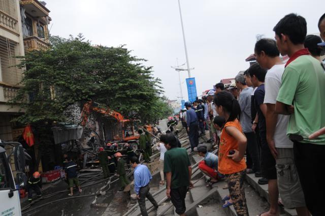 Nhà năm tầng thành đống đổ nát vì hỏa hoạn - ảnh 9