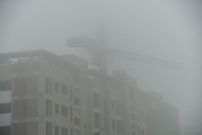 Hà Nội mịt mù trong sương dày đặc - ảnh 13