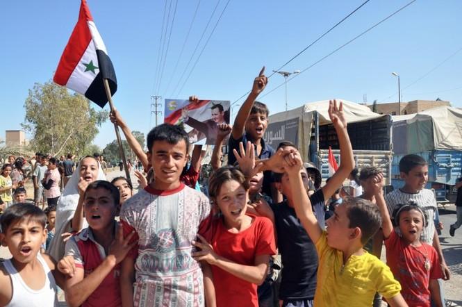 Thế giới tuần qua: Triều Tiên sôi sục, Syria mừng ngày giải phóng - ảnh 6