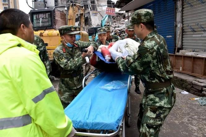 Hiện trường vụ sập 4 nhà cao tầng kinh hoàng ở Trung Quốc - ảnh 6