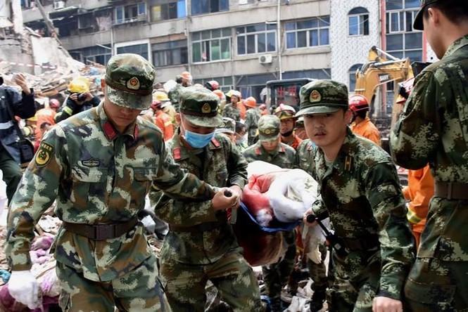 Hiện trường vụ sập 4 nhà cao tầng kinh hoàng ở Trung Quốc - ảnh 7