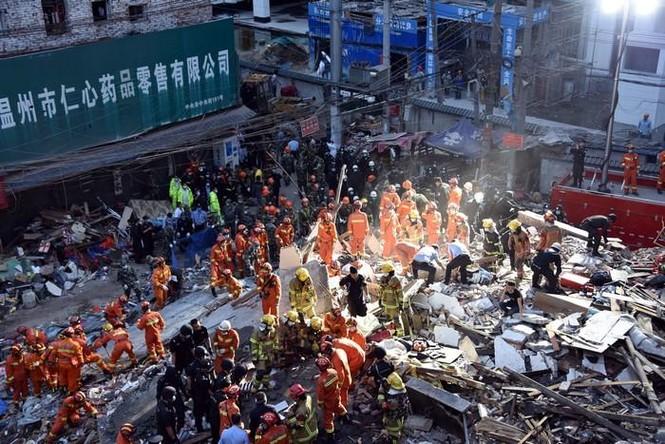 Hiện trường vụ sập 4 nhà cao tầng kinh hoàng ở Trung Quốc - ảnh 8