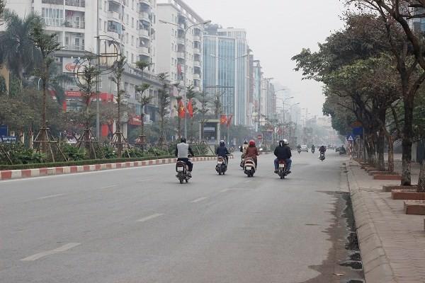 Đường phố Hà Nội vắng vẻ ngày đầu năm mới 2017 - ảnh 6