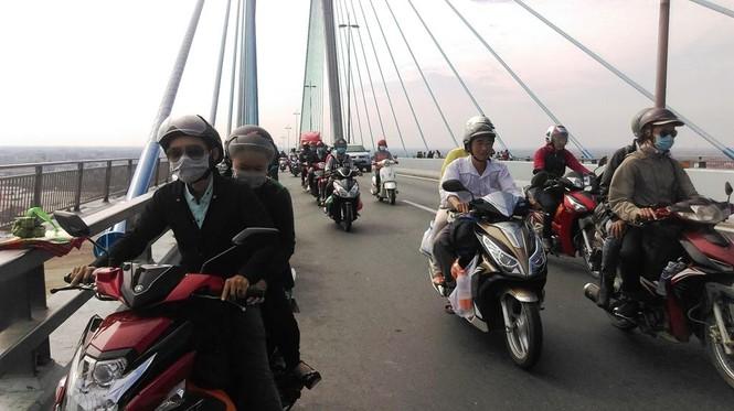 Dân miền Tây ùn ùn trở lại Sài Gòn sau Tết - ảnh 5