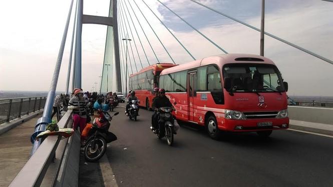 Dân miền Tây ùn ùn trở lại Sài Gòn sau Tết - ảnh 8
